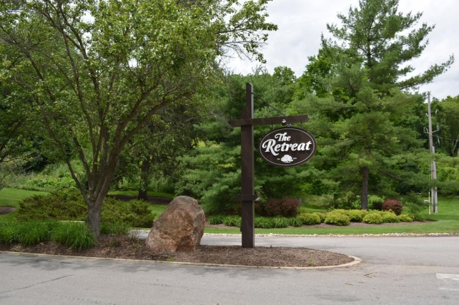 The Retreat neighborhood entrance sign