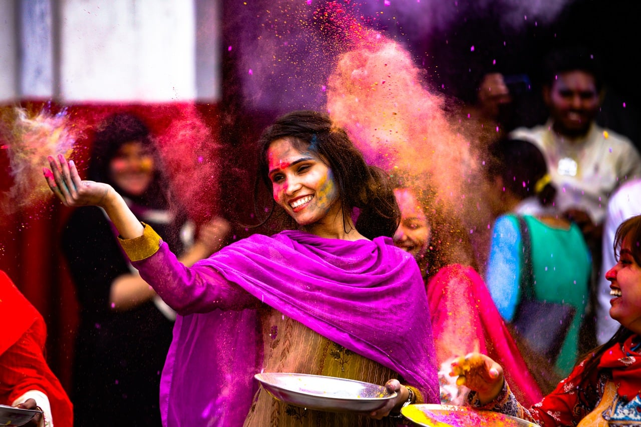 Holi celebration with colored dyes.