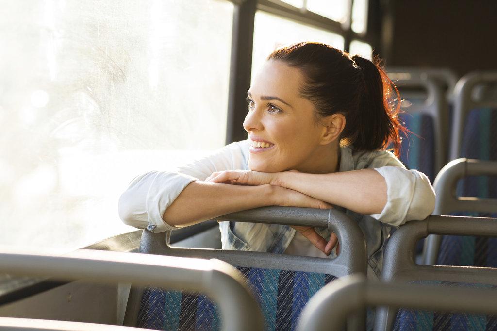 person riding on a public bus