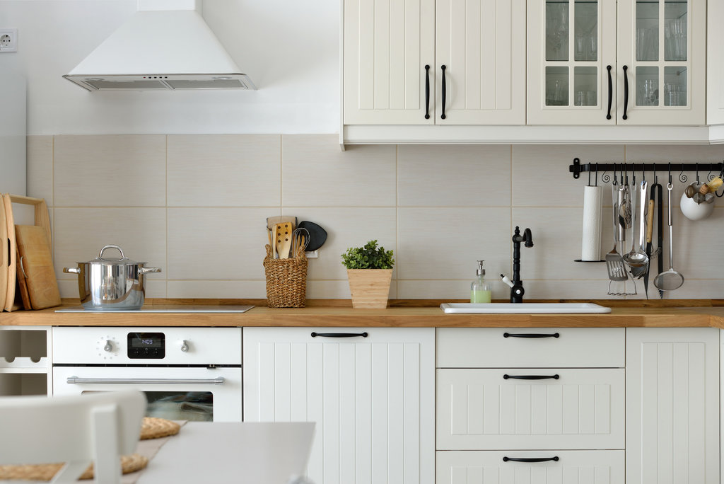 kitchen with white appliances and cabinets
