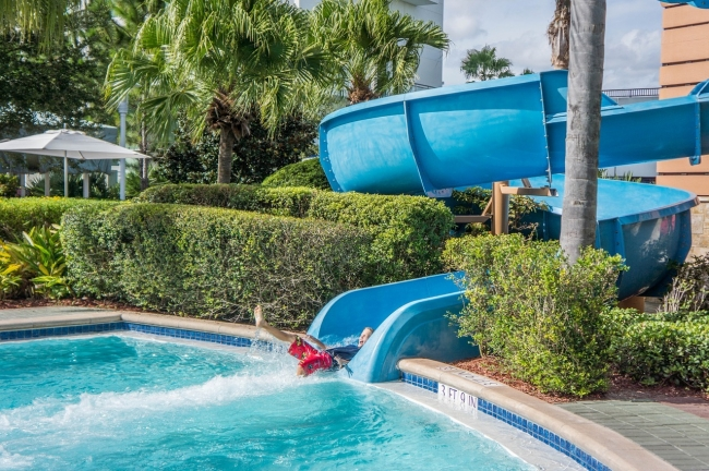 Residents of all ages will love going down the water slides at the community pool!