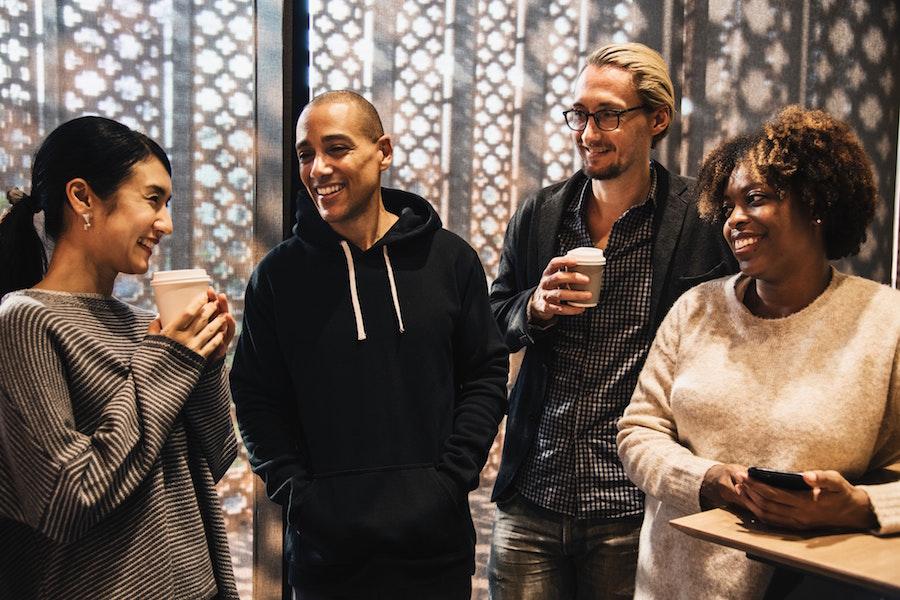 Four friends enjoying coffee together.