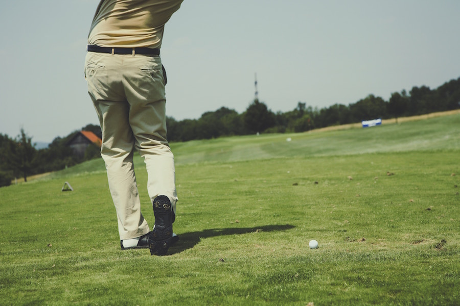 A person golfing.