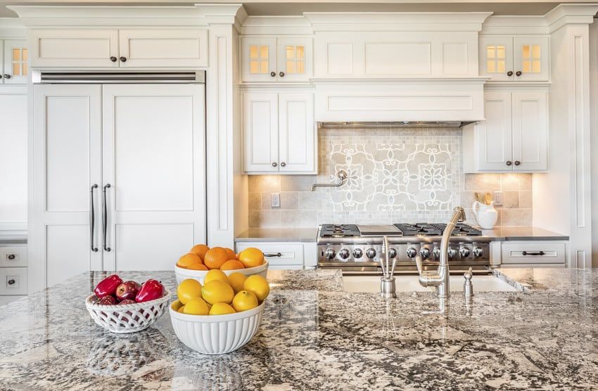 A luxurious kitchen with granite countertops.