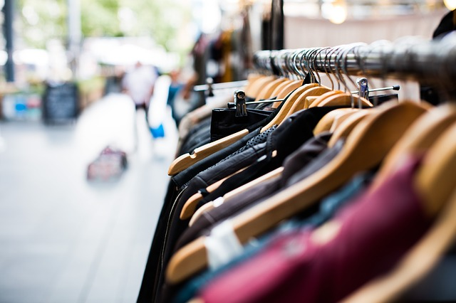 shot of a rack of clothes with blurred background.