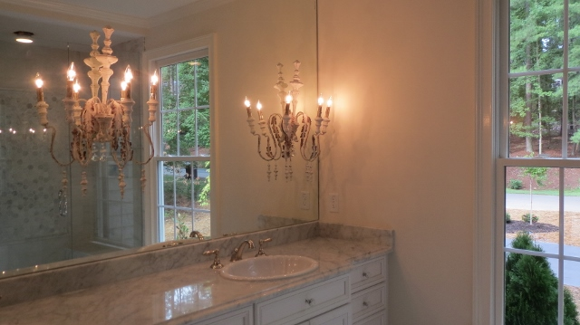 frameless mirror with sconces