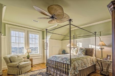 beachy bedroom interior with fan