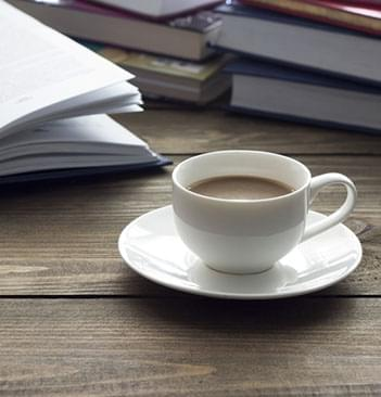 novel and a hot cup of coffee