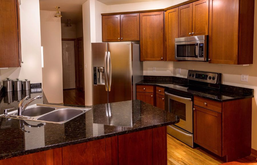 A kitchen with newer countertops.