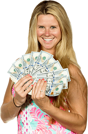 Smiling woman holding up a fan of $100 bills