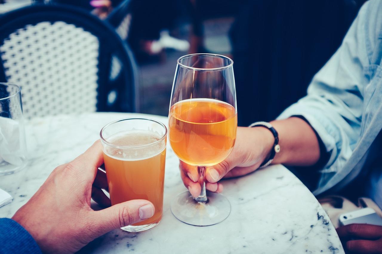 Two people cheering their beers