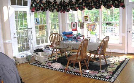 dining room with laundry and art projects