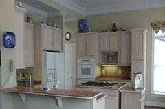 Before: Dark kitchen with salmon-colored countertops
