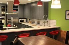 After: Kitchen with modern lighting and seating + color updates