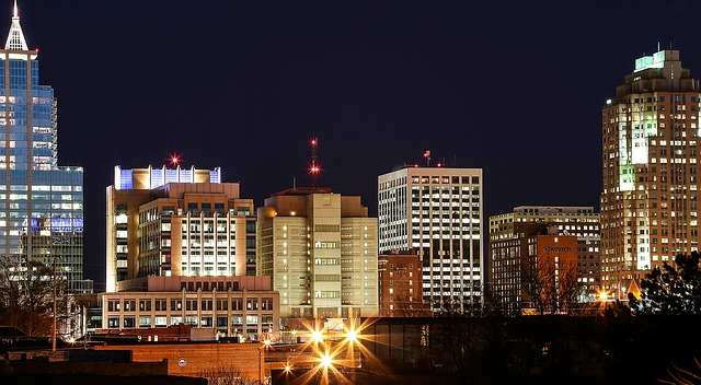 View of the tops of buildings in Downtown Raleigh at night.