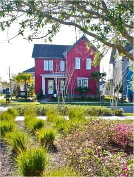 Red home with landscaping