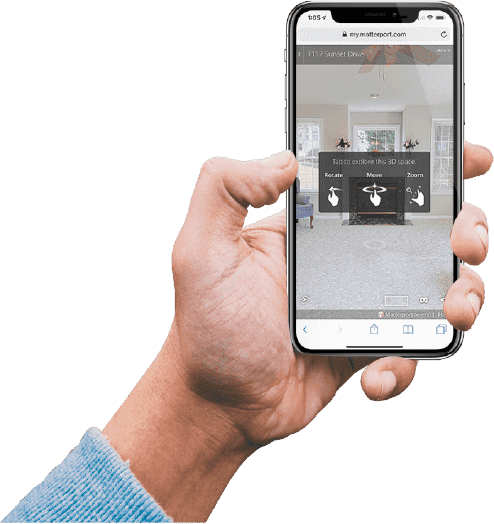 hand holding phone with video tour on screen