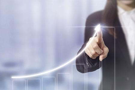 woman drawing upward graph