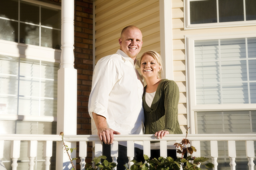 two homeowners outside a house