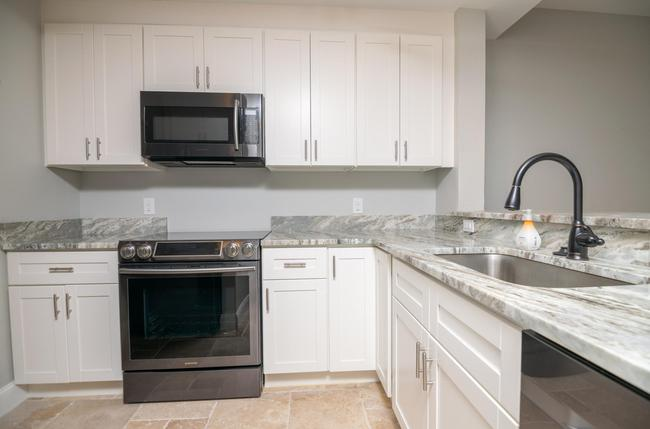 The kitchen features modern updates with a high end appliance package.