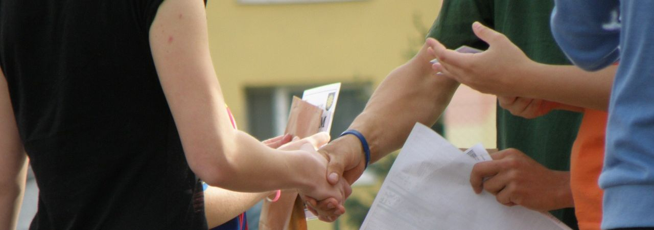 Realtors shaking hands with homeowners