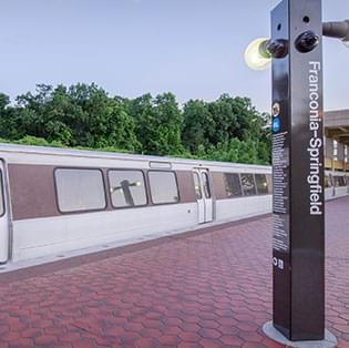 Metro going by at Fraconia-Springfield Station
