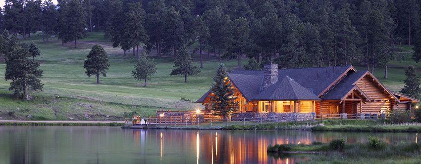 stunning log cabin estate on a lake in grand forks