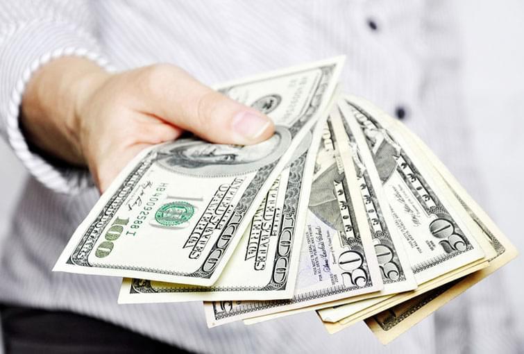 hand holder $100 bills