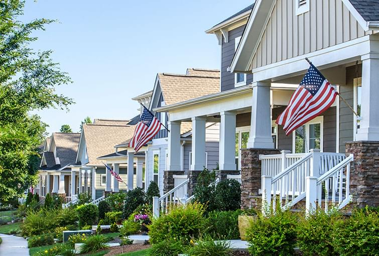 homes with porches and American flags