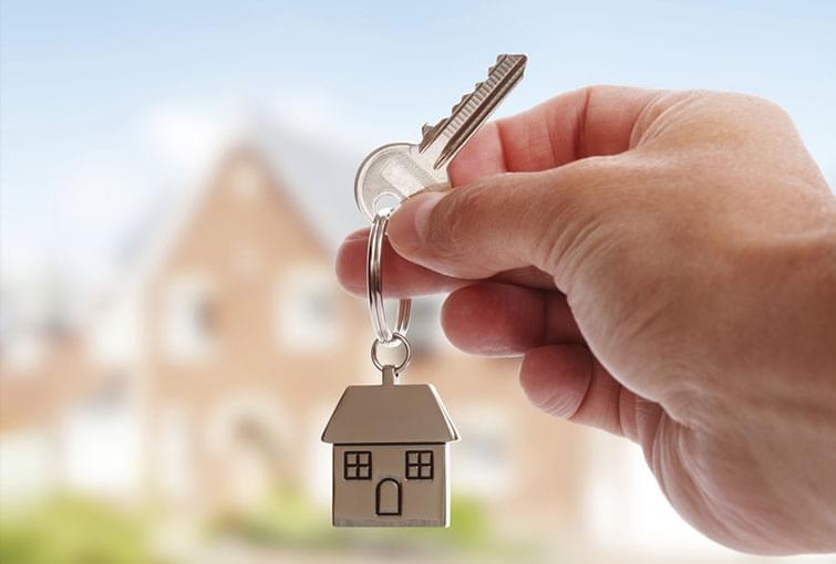 eal estate agent holding keys to home