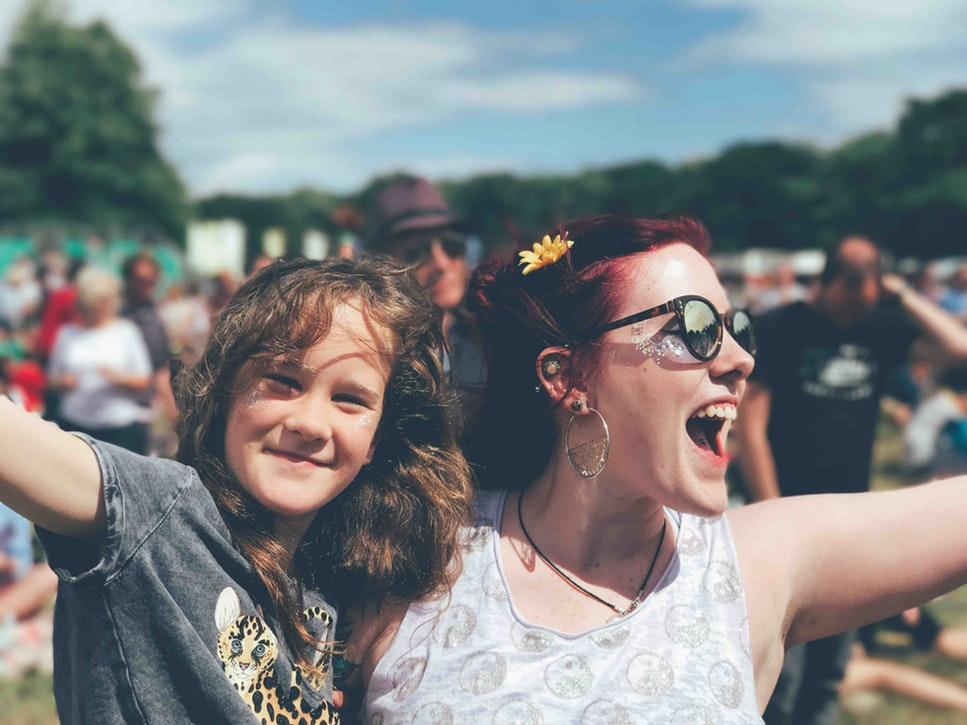 A woman and child at a festival