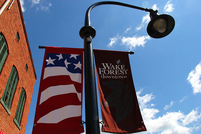 Banner for Downtown Wake Forest on a street light.