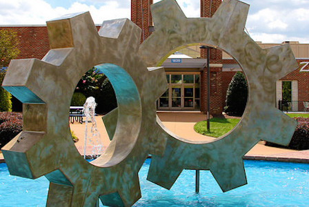 Closeup of two cogs in a fountain by Wake Forest's Factory shopping center.