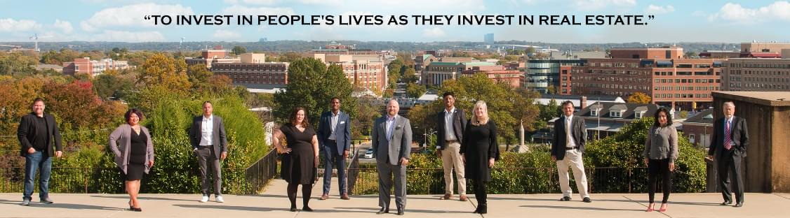 Team photo with quote 'to invest in people's lives as they invest in real estate