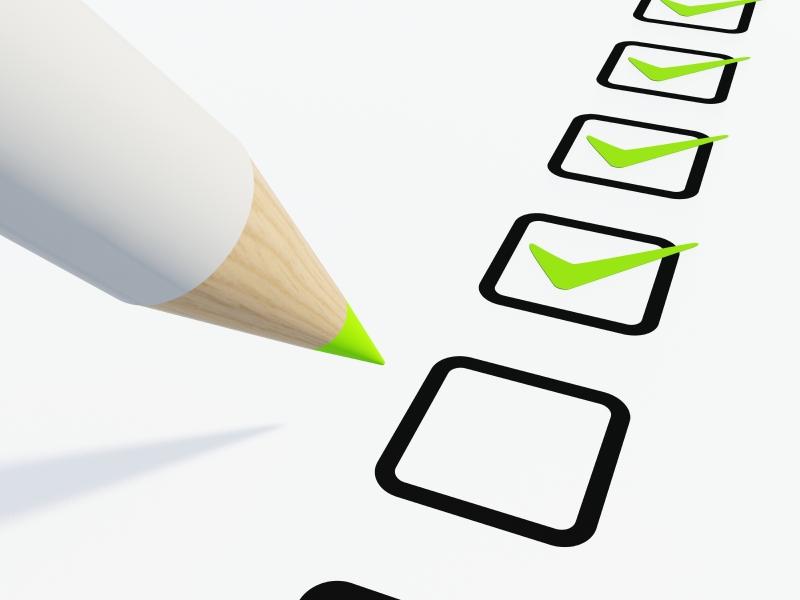 a pencil and check box list