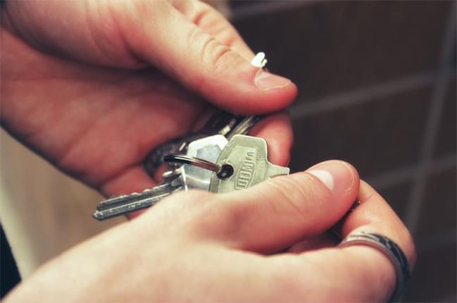 hands holding house keys