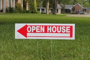 sign pointing to available home for sale