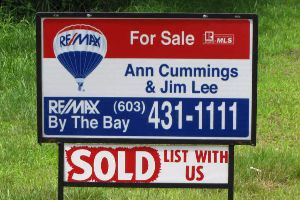 Ann Cummings and Jim Lee's sold sign in front of a home.