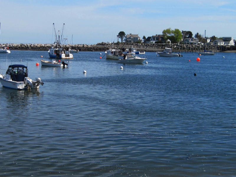 Fishing boats sailing on Rye Harbor in New Hampshire.