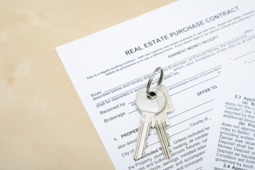 a home sale contract and house keys