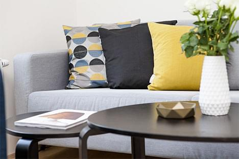 modern couch with geometric decor