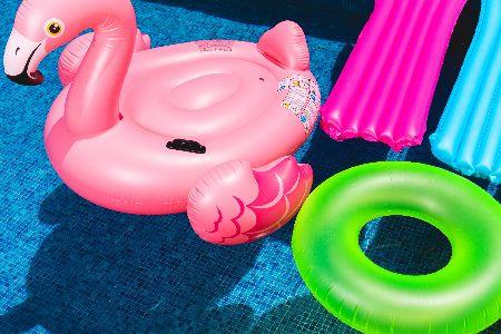 Swim floaties floating in pool.