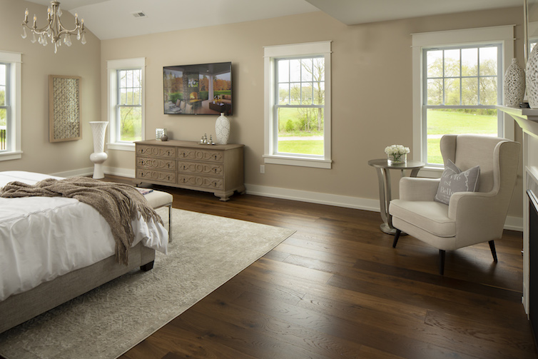 Angled view of staged luxurious master bedroom