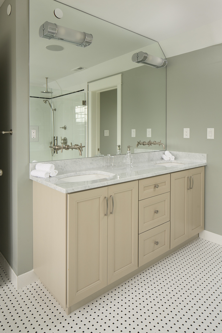 Bathroom counter with granite top and light wood base