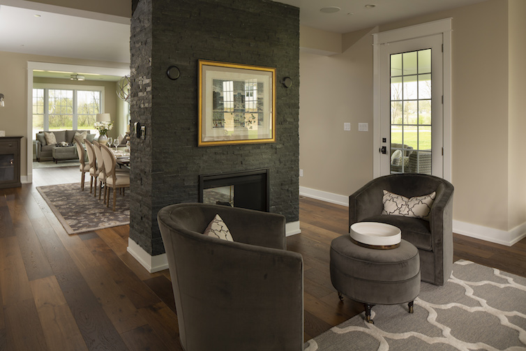 Dark stone fireplace view from living room