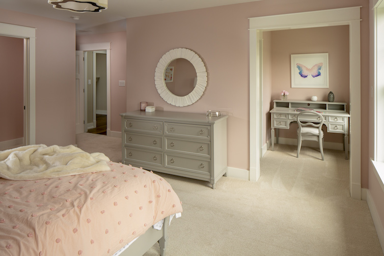 Staged all pink bedroom with desk