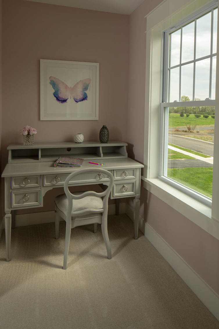 View of desk area in all pink room