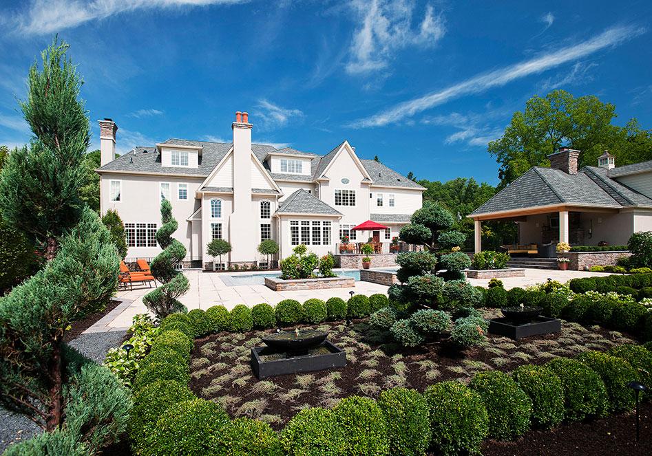 back yard of large white mansion