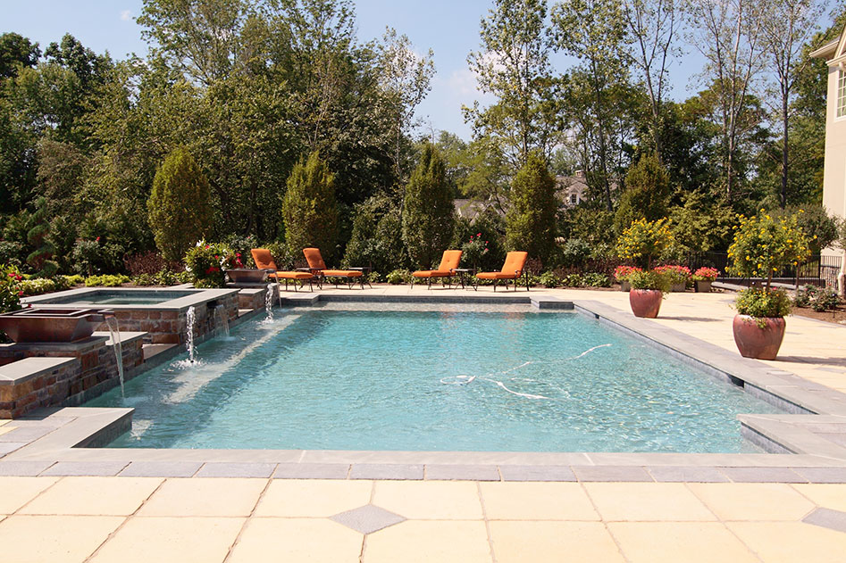 backyard luxury pool with fountain
