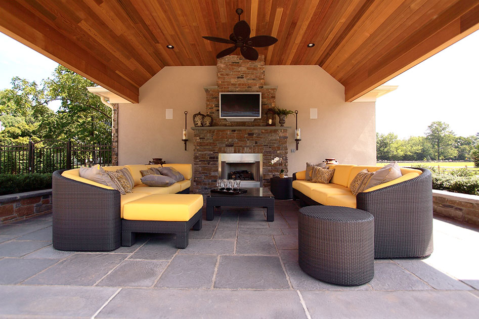 outdoor entertainment lounge with fireplace